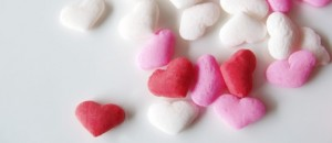 pink, white and red candied heart spinkles on white background